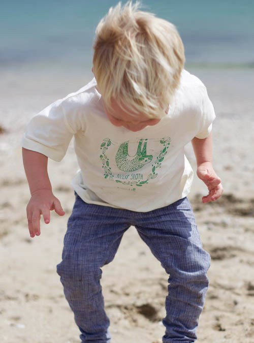 sleepy sloth kids t-shirt on beach